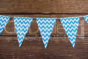 Bunting arranged on wooden table