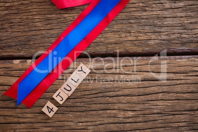 Date blocks with red and blue ribbon on table