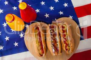 Hot dog on heart shape wooden board with 4th July theme