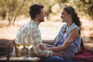 Loving young couple sitting on mat