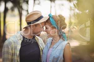 Young couple rubbing noses at olive farm