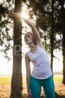 Young woman exercising on field at farm