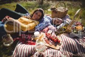 Portrait of happy young couple lying together on blanket
