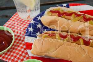 Close-up of hot dog served in plate on wooden table