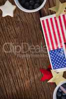 American flag and star shape decoration arranged on wooden table