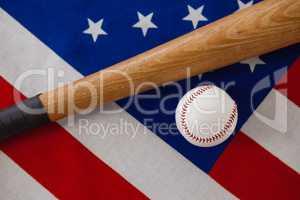 Baseball bat and ball on American flag