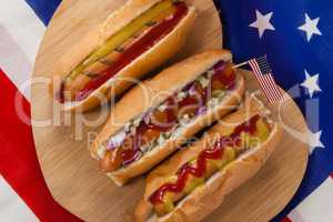 Hot dog and American flag on white wooden table