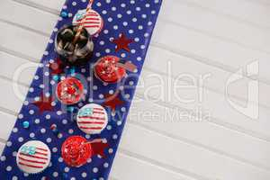 Decorated cupcakes and cold drink with 4th july theme