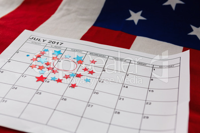 Calendar marked with star shape decoration