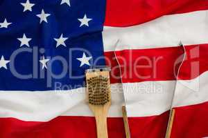 Tong and brush on American flag
