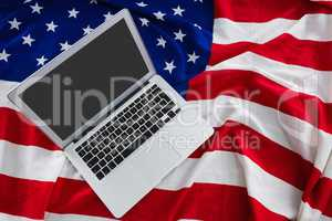 Laptop on American flag with 4th july theme