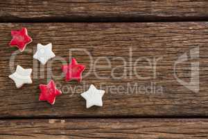 Red and white sugar cookies arranged on wooden table