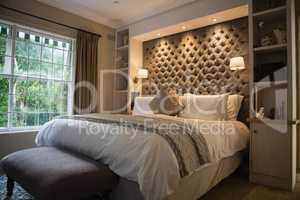 Illuminated neat bedroom