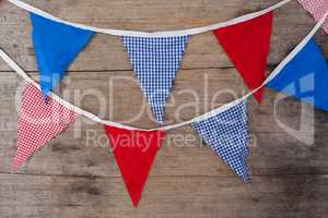 Bunting flags arranged on wooden table