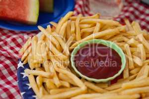 French fries with ketchup in plate