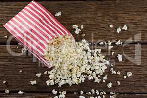 Scattered popcorn on wooden table
