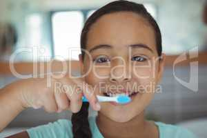 Girl brushing teeth in the bathroom