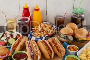 Drinks and snacks on wooden table