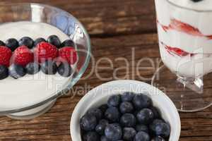 Fruit ice cream and blueberry on wooden table