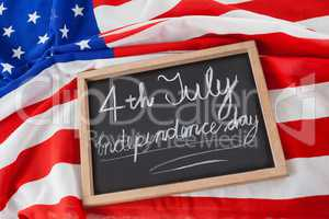 American flag and slate with text 4th july independence day