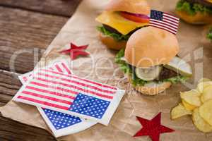 Burger and potato chips decorated with 4th july theme