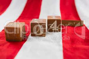Date blocks on American flag with 4th july theme
