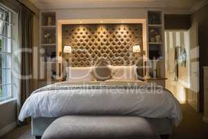 Interior of illuminated bedroom
