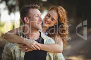 Happy young couple enjoying at olive farm on sunny day