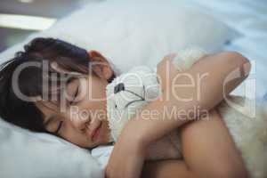 Girl sleeping on the bed in bed room