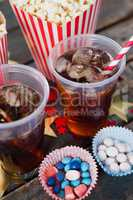 Popcorn, confectionery and drink with 4th july theme