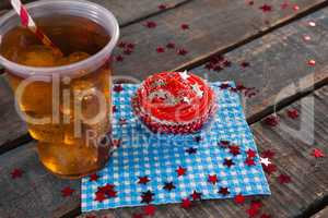 Decorated cupcake and cold drink with 4th july theme