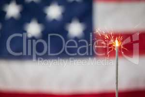 Sparklers burning against American flag background