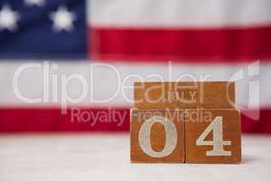 Date blocks arranged against American flag background
