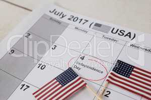 American flags with fourth of july calendar