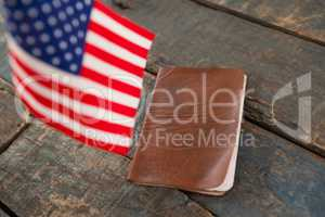 Visa and American flag on a wooden table