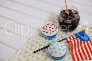 Close-up of drink and cupcake with 4th july theme