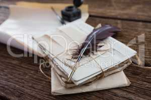 Quill feather with legal documents arranged on table