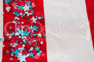 Star shape decoration arranged on American flag