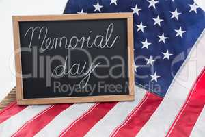 American flag and slate with text memorial day