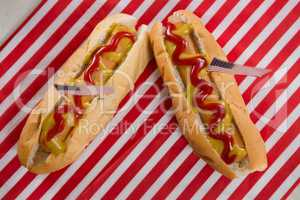 American flag and hot dogs on wooden table