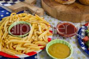 French fries on wooden table with 4th july theme