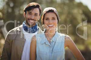 Happy young couple on sunny day at olive farm