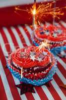 Burning sparkler on decorated cupcakes