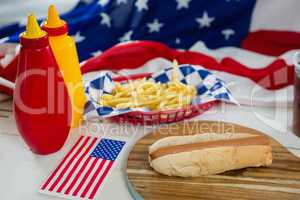 American flag and burgers on wooden table