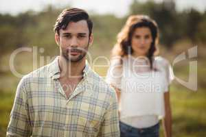 Handsome young man with woman at farm