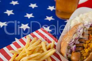 Hot dog and french fries on wooden tale