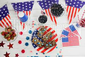 Sweet food and fruits decorated with 4th july theme
