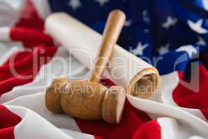 Gavel and legal document arranged on American flag