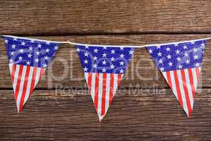 Patriotic bunting arranged on wooden table