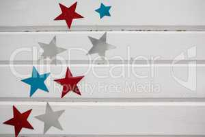 Star shape decoration arranged on wooden table